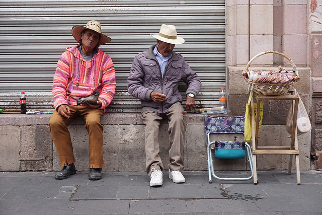 Two men selling candy in the streets of downtown Zacatecas.